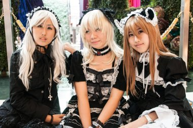 BANGKOK, THAILAND - 30 AUGUST 2008: three girls dressed as maid during a cosplay festival in front of Siam Pagagon, Bangkok
