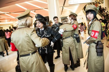 BANGKOK, THAILAND - 30 AUGUST 2008: a group of young girls dressed in military costume participate in a cosplay festival inside the Siam Pagagon, Bangkok