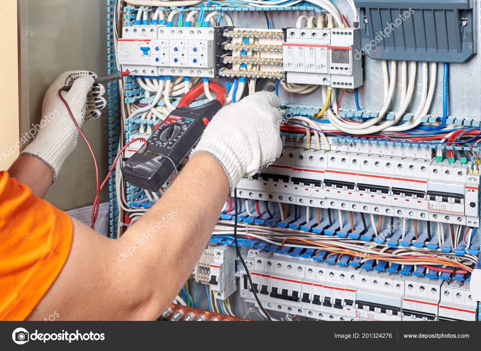 engineer tests power high voltage three phase circuit box with multimeter  electric  service power system  support electrician in fuse panel