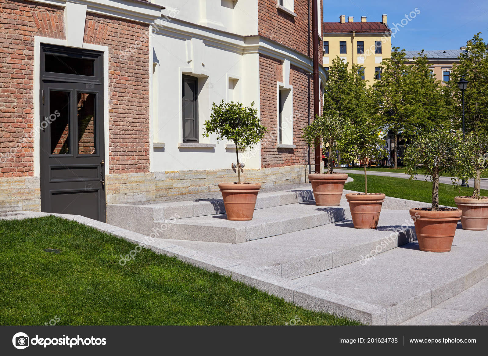 An Old Brick House With Windows And Potted Flowers In Front Of The Victorian Style Entrance Against A Blue Sky Green Lawn Photo By Accent Pmail