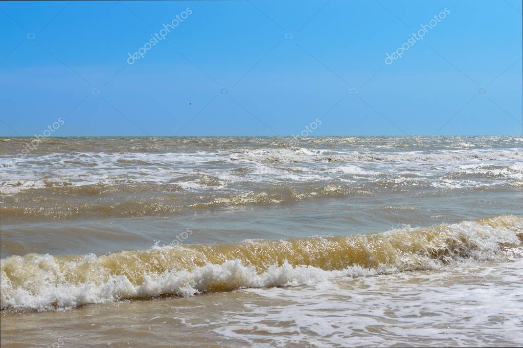 Waves on the shore. Sea wave with sunlight. Beautiful view of the sea and blue sky. Seascape.
