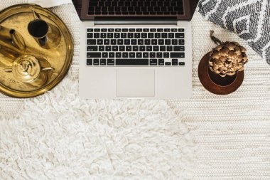 Top view decorated home office desk workspace laptop. Flat lay modern styled business concept. Blog or social media hero header. Minimal boho background.