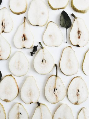 Pear slices pattern on white background. Flat lay, top view minimal concept.