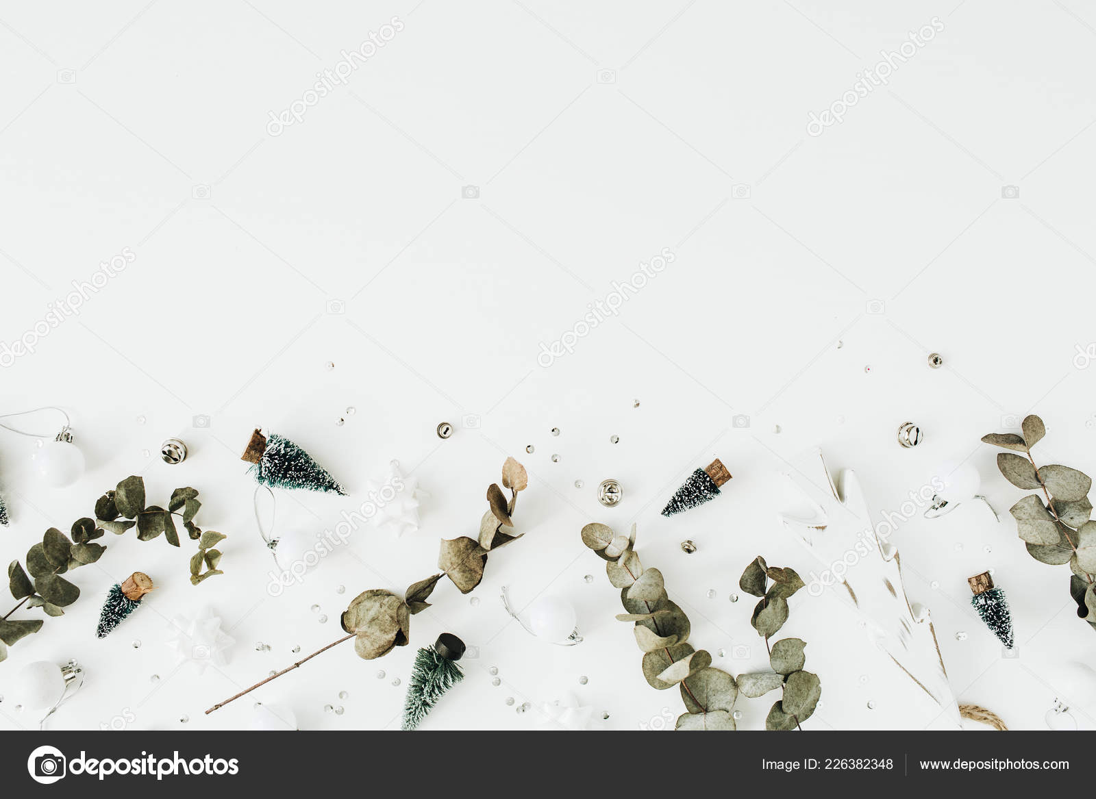 christmas new year festive composition on white background flat lay top view blog hero header photo by maximleshkovich