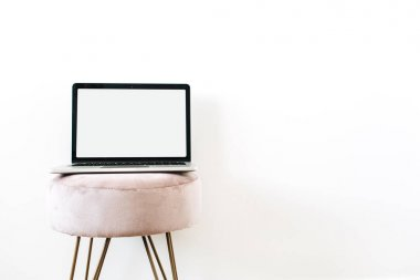 Copy space mockup screen laptop on stylish stool on white background. Minimalist blog, website, social media hero header.