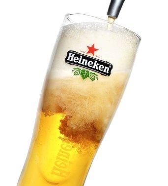 Glass of original Heineken beer on white background