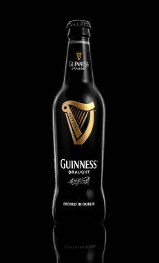 Bottle of original Guinness beer on black background