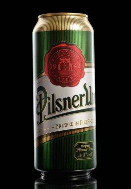 Bottle of original Pilsner Urquell beer on black background