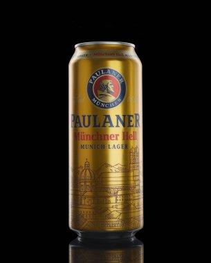 Bottle of original Paulaner beer on black background
