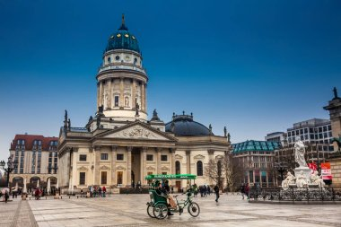 BERLIN, GERMANY - MARCH, 2018: The New Church also called German Church  on Gendarmenmarkt in a cold end of winter day