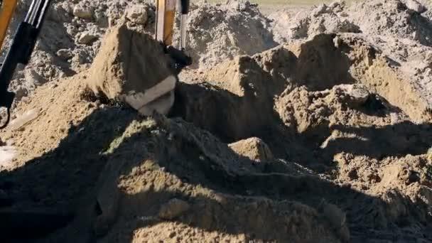 Detail kbelík rypadlo zvýší na zem. Koncepce výstavby.