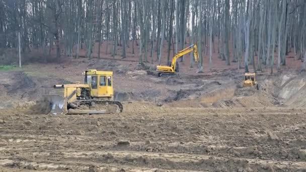 UKRAINE LVIV December 29th 2018. Work of excavators and bulldozers on the construction site. Ground alignment