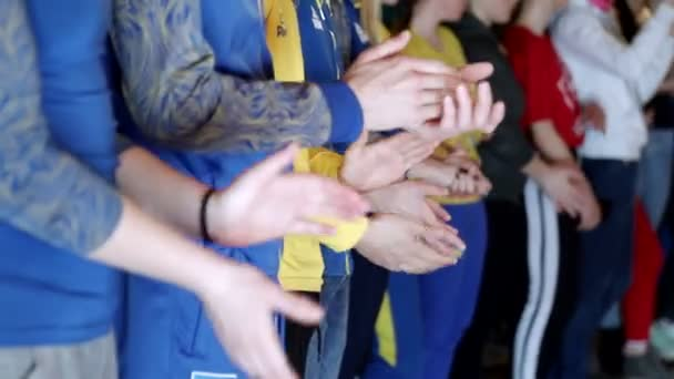 Close up of the hands of children who applaud