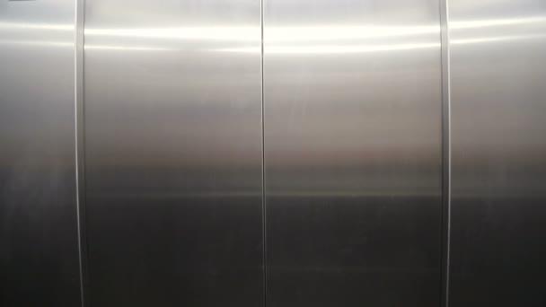 Elevator doors open. Opening the door is an elevator. The door opens and views of the ground floor to the restaurant
