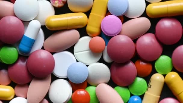 Different colorful pills and drugs rotating. Medicinal tablets capsules pills turning seamless loop.