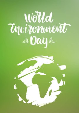 Handwritten type lettering composition of World Environment Day with hand drawn Earth on green blurred nature background