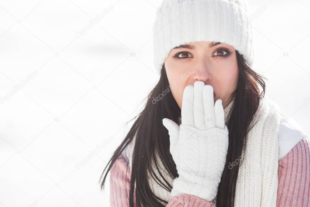 Close up portrait of young beautiful woman in winter time