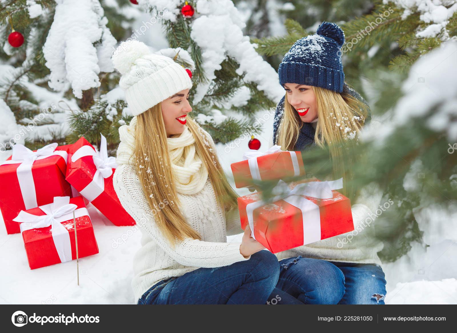 Ladies Christmas Gifts.Girlfriends Having Fun Christmas Presents Outdoors Women