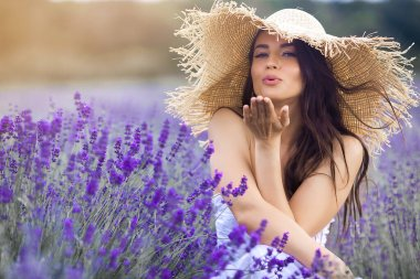 Beautiful young woman in lavender field