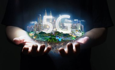 Unknown hand holding fantasy island floating in the air with 5G network wireless systems , Smart city and communication network concept .