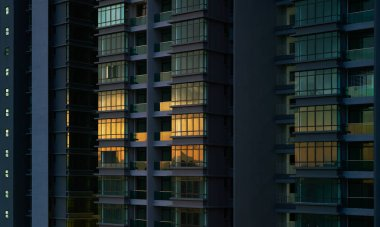 Modern apartment buildings on night. Facade of a modern apartment building