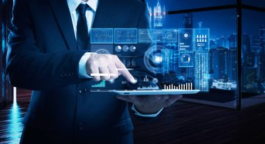 Businessman working on digital table with intelligence and analytics of business showing on virtual screen .