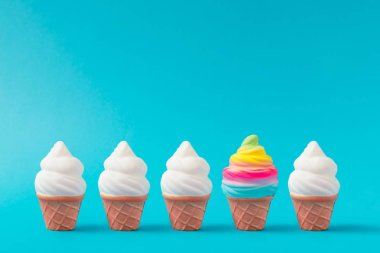 Colorful and white ice cream on pastel blue background, Creative minimal summer concept