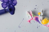 White dinosaur painted with vivid colors. Minimal surreal fun school concept