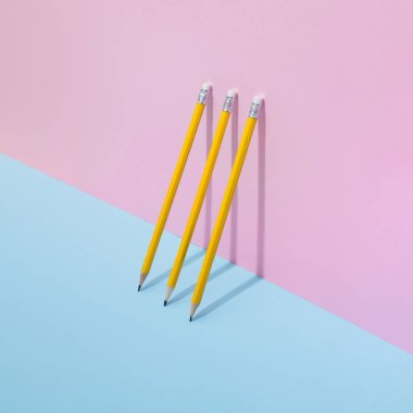 School color pencils on pastel background. Minimal concept art