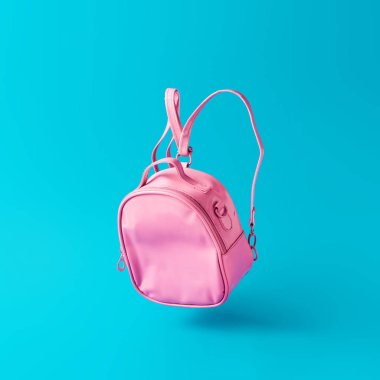 Pastel pink school bag floating on sky blue background, Surreal modern still life. Back to school minimal concept