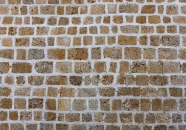 ancient natural stone wall as a texture or background