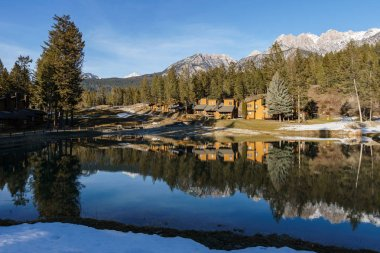 FAIRMONT HOT SPRINGS, CANADA - MARCH 19, 2019: vacation villas in small town situated in rocky mountains.