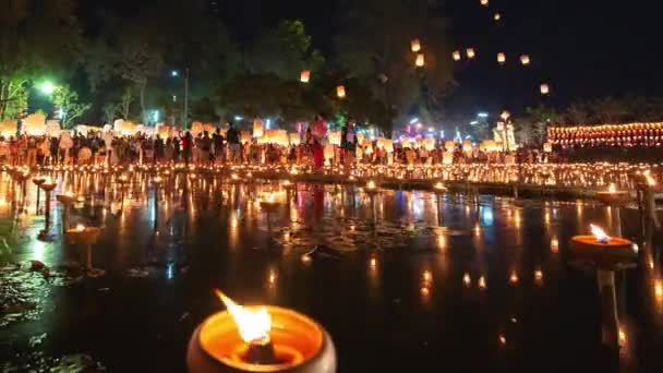 4K Timelapse of Floating lanterns and People in Yee Peng Festival or Loy Krathong celebration at Nong Bua, San Kamphaeng, Chiang Mai, Thailand (Right-Left)