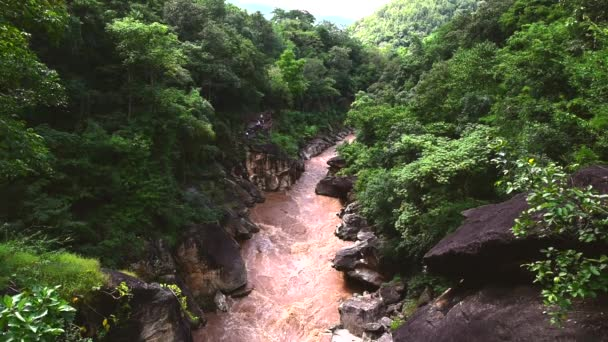 Beautiful nature with large rock hill mountain water flowing and wood bridge link a cliff above the river in the forest at Obluang national park, Chiangmai, Thailand.