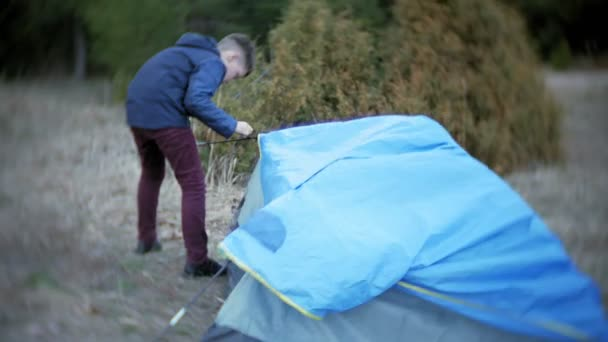 children gather a tourist tent on the nature in the forest