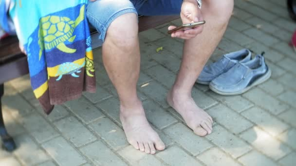 Friends without shoes together, summer, a group of people after the beach on a bench