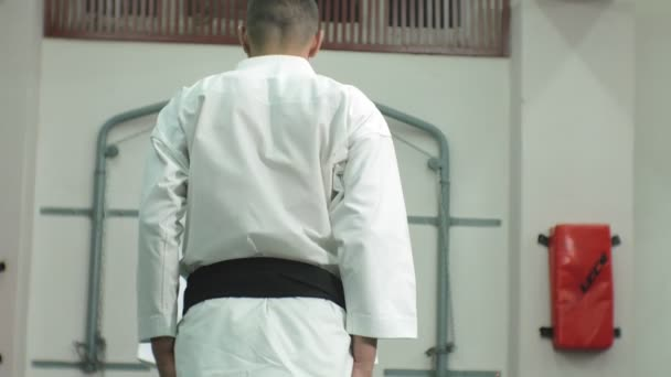 A young man with a muscular body and a woman practicing martial arts Goju-Ryu Karate-Do