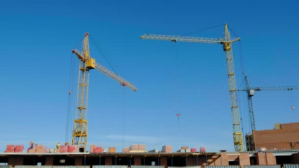 Building construction, work of people and crane