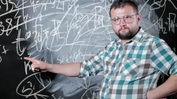 A brilliant mature mathematician brings a big board and completes an essay Complicated mathematical formula equation