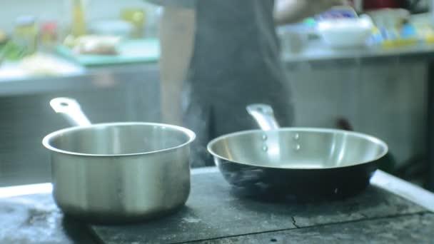 cook in the kitchen of the restaurant prepares pasta carbonara
