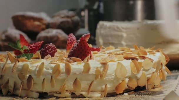 The concept of cooking. Professional pastry chef makes a delicious cake, closeup