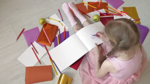 little girl draws with pencils, childrens creativity, development