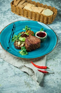 Steak with barbecue vegetables and lingonberry sauce