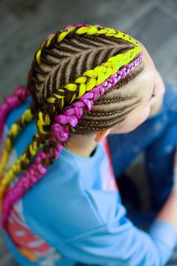 creative hairstyle of thin and thick plaits with interweaving ne