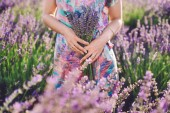 Girl Holding Bouquet on Lavender Field