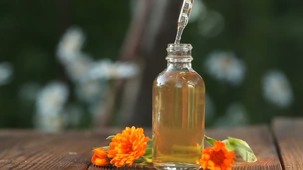Essence of lavender flowers on table in beautiful glass bottle