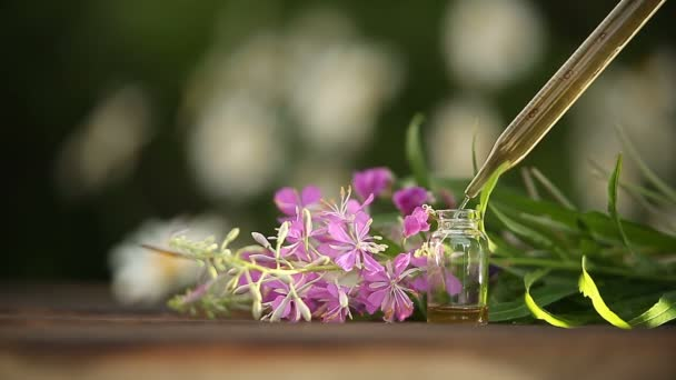 blooming Sally essential oil in  beautiful bottle on table