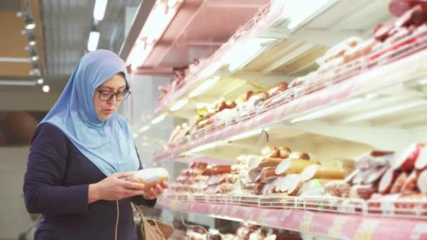 attractive woman in hijab 40 years of shopping, meat department