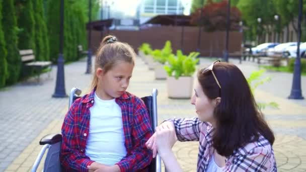 Teenager disabled in a wheelchair talking to a girl