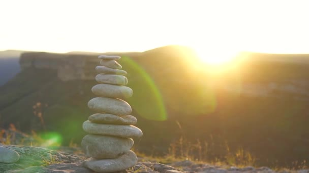 Stone pyramid at sunset.The concept of balance